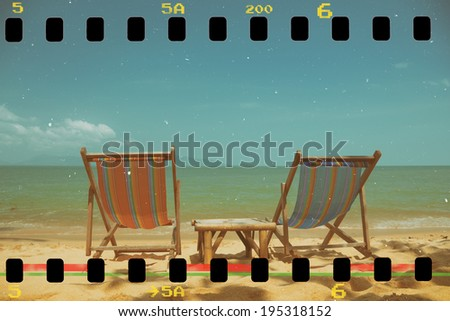 Vintage toned two beach chairs on tropical shore, retro toned and film stylized - stock photo