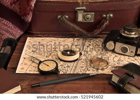 Vintage tools of a traveler, compass,  camera, suitcase and map