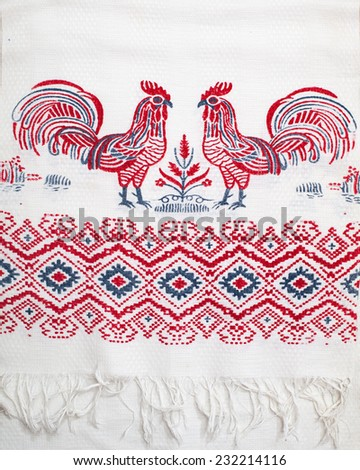 vintage towel with a painted pattern, Cocks and ornament - stock photo