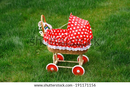Vintage toy doll buggy - stock photo