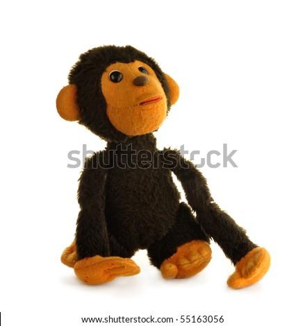 Vintage toy - monkey, isolated on white background - stock photo