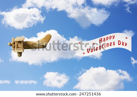 Vintage toy plane pulling a Valentines Day banner - stock photo