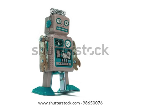 Vintage toy robot isolated on white background - stock photo