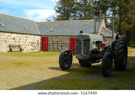 Vintage Tractor and Farm Buildings - stock photo