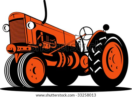 Vintage tractor isolated on white viewed from a low angle - stock photo