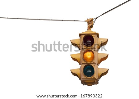 Vintage traffic light flashing yellow caution isolated on a white background - stock photo