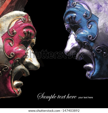 Vintage tragedy theater masks on black background - stock photo