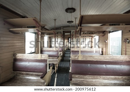 Vintage train interior with wooden seats