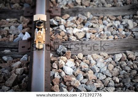 Vintage train toy model on rail. - stock photo