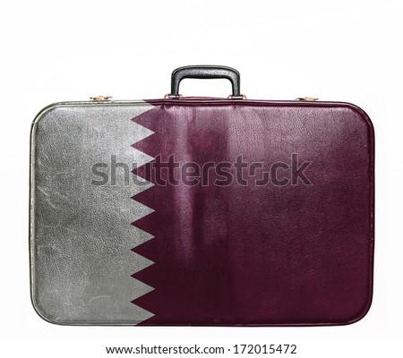 Vintage travel bag with flag of Qatar - stock photo