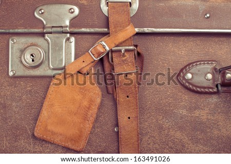 Vintage travel case with leather tag for background