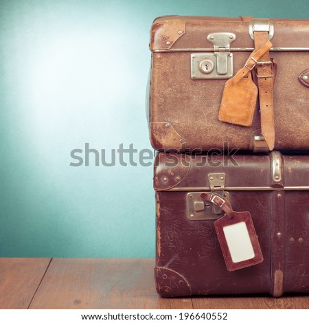 Vintage travel valises with leather name labels - stock photo