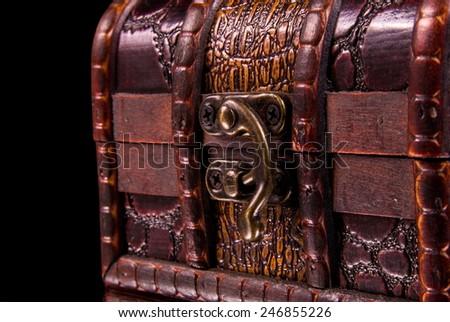 vintage treasure chest closeup on black - stock photo