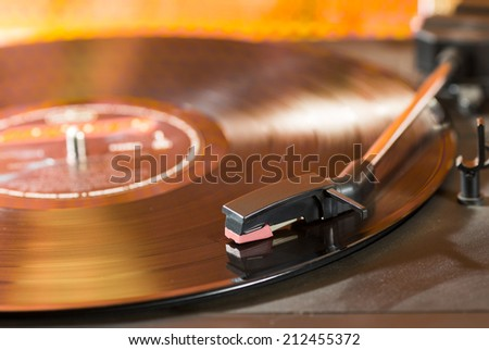 Vintage turntable with a record playing - stock photo