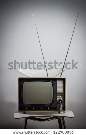 vintage tv on a white chair