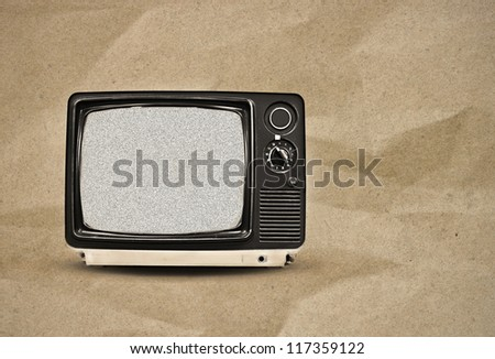 vintage tv on paper background - stock photo
