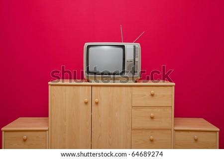 Vintage TV set on a cabinet - stock photo
