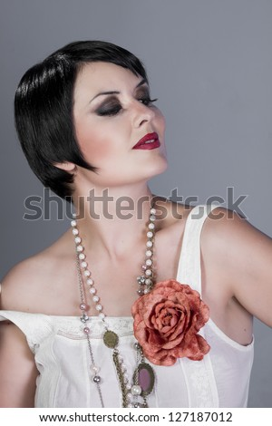 Vintage twenties young wearing a flapper dress - stock photo