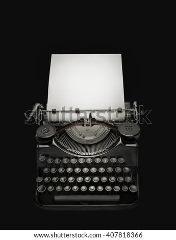 Vintage typewriter aginst black  background. Low key edition of an ancient typewriter integrated on black background to give prominence to the space for text at the white page. Clipping path - stock photo