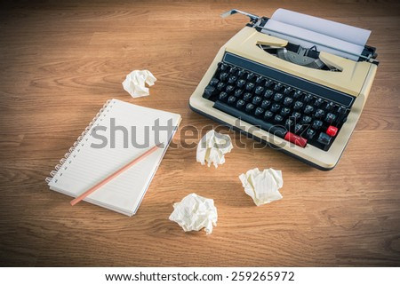 Vintage typewriter and a blank notebook of paper, retro style - stock photo