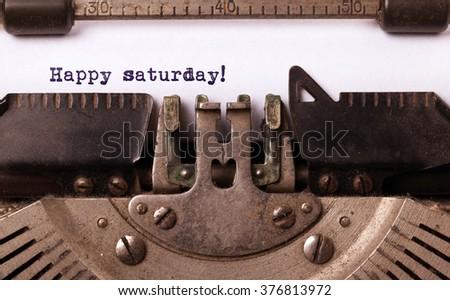 Vintage typewriter close-up - Happy saturday, concept of motivation - stock photo