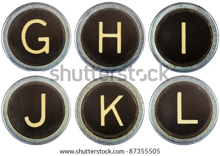 Vintage typewriter letters GHIJKL isolated on white - stock photo