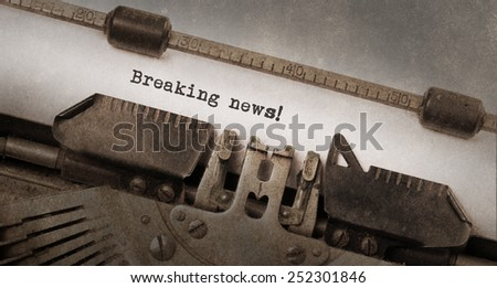 Vintage typewriter, old rusty and used, breaking news - stock photo