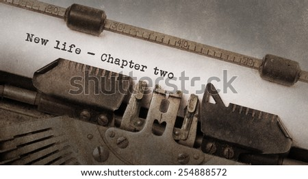 Vintage typewriter, old rusty and used, new life chapter 2 - stock photo