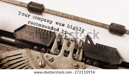 Vintage typewriter, old rusty and used, Your company was highly recommended by - stock photo