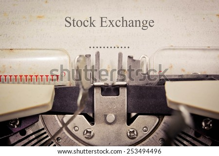 Vintage typewriter, old rusty, warm yellow filter - Stock exchange
