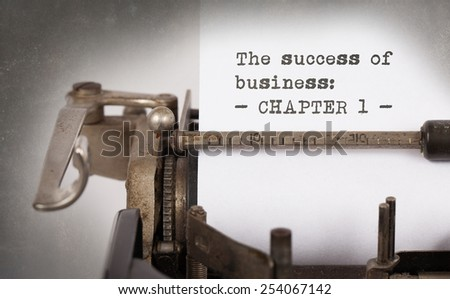 Vintage typewriter, old rusty, warm yellow filter - The succes of business, chapter 1 - stock photo