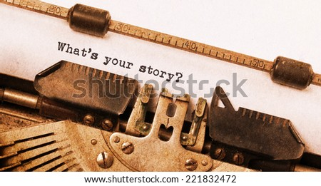 Vintage typewriter, old rusty, warm yellow filter - What's your story - stock photo