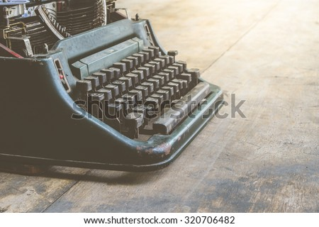 Vintage typewriter on a wood table , process in vintage style - stock photo