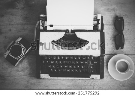 vintage typewriter on the wood background back and white color - stock photo