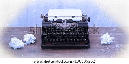 Vintage typewriter on wooden table, touch-up in retro style - stock photo