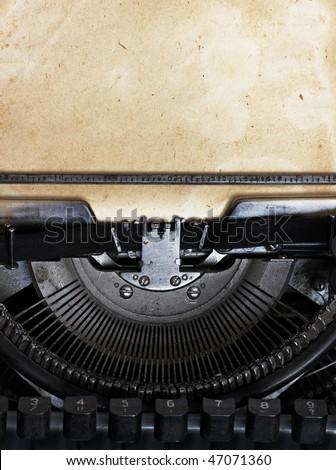 vintage typewriter with paper - stock photo