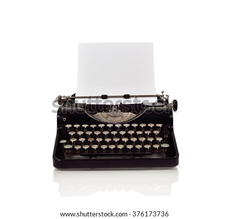 Vintage typewriter with paper on a white background - stock photo