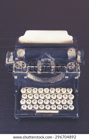 Vintage typewriter with stone carved keys photographed with shallow depth of field. Image cross processed for vintage look. - stock photo
