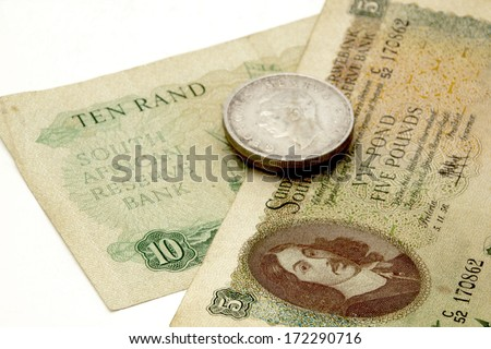 vintage union of south african banknotes and silver coins - stock photo