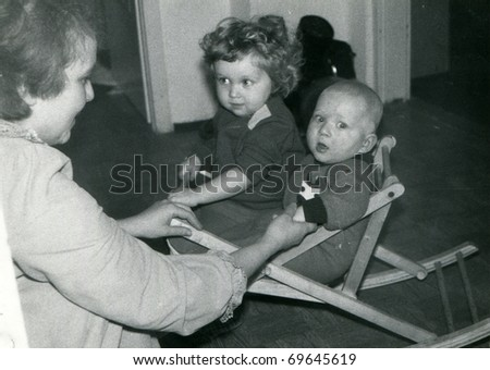 Vintage unretouched photo of mother and children - stock photo