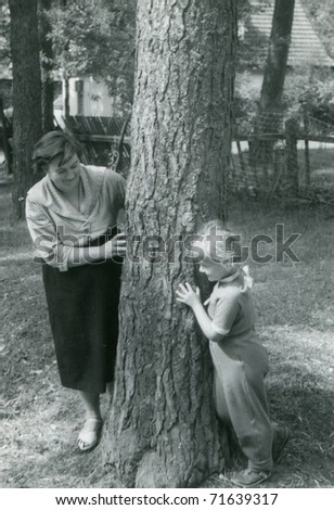 vintage unretouched photo of mother and daughter (fifties) - stock photo