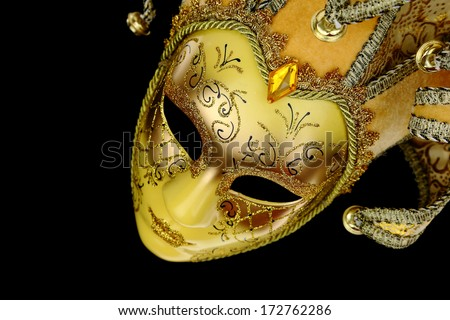 Vintage venetian carnival mask on black background - stock photo
