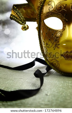 Vintage venetian carnival mask with glittering background - stock photo