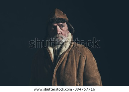 Vintage veteran aviator wearing winter coat and leather cap.  - stock photo