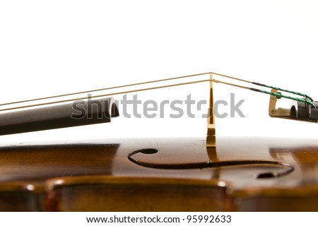 Vintage viola bridge and strings close up isolated on white background - stock photo