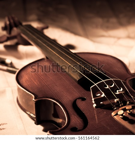 Vintage violin and bow in still life concept - stock photo