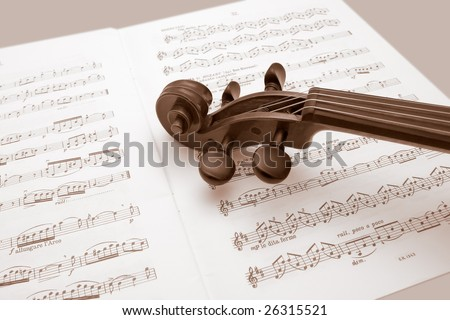 Vintage violin resting over a sheet music - stock photo