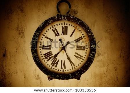 Vintage wall clock. - stock photo