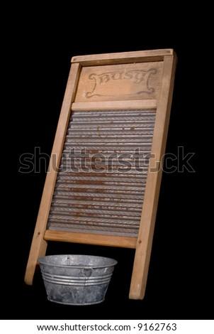 Vintage washboard and miniature galvanized washtub, black iso. - stock photo