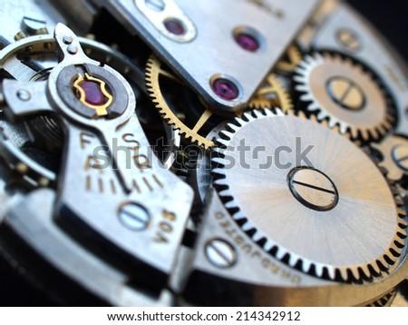 vintage watch machinery macro detai - stock photo